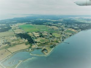 Image: Penn Cove from the air, looking at Kennedy Lagoon (NC-18.1). Photo Credit: Darcy Bird